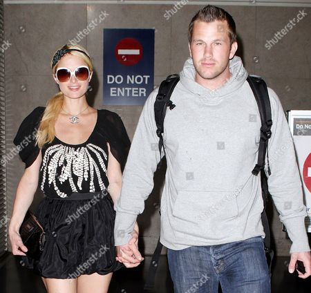 Editorial image of Paris Hilton and Doug Reinhardt arriving at the LAX airport, Los Angeles, America - 22 Mar 2010