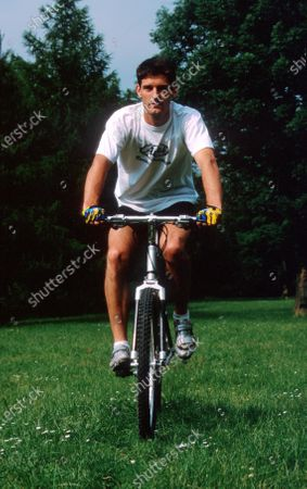 Stock Photo of Mark Webber (AUS) likes to cycle through his local forest. Drivers at Home Feature, 16 July 2000.
