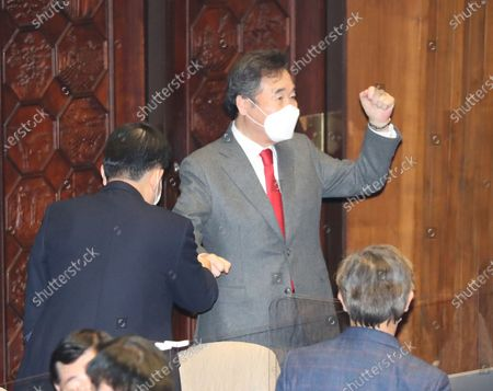 Lee Nak-yon, chief of the ruling Democratic Party, raises his fist at a plenary session of the National Assembly, after lawmakers pass a controversial bill prohibiting the launching of anti-Pyongyang leaflets across the inter-Korean border, in Seoul, South korea, 14 December 2020. Lawmakers of the main opposition People Power Party left the session in protest, abstaining from a vote on the bill. The revision to the Development of Inter-Korean Relations Act outlaws the scattering of leaflets critical of North Korean leader Kim Jong-un or his political system across the border.