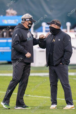New Orleans Saints head coach Sean Payton talks things over with Philadelphia Eagles head coach Doug Pederson prior to the NFL football game, in Philadelphia