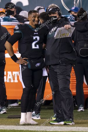 Philadelphia Eagles quarterback Jalen Hurts (2) talks things over with head coach Doug Pederson during the NFL football game against the New Orleans Saints, in Philadelphia