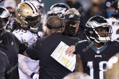 Philadelphia Eagles head coach Doug Pederson gives New Orleans Saints head coach Sean Payton a hug following the NFL football game, in Philadelphia