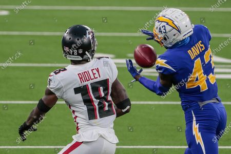 Inglewood, CA, Sunday, Dec. 13, 2020 Los Angeles Chargers cornerback Michael Davis (43) steps in front of Atlanta Falcons wide receiver Calvin Ridley (18) to intercept a Matt Ryan pass late in the game at SoFi Stadium. (Robert Gauthier/ Los Angeles Times)