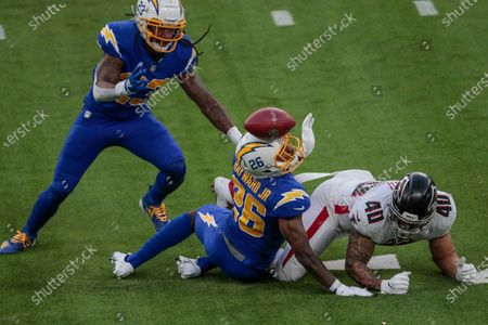 Inglewood, CA, Sunday, Dec. 13, 2020 Los Angeles Chargers cornerback Casey Hayward (26) and Los Angeles Chargers strong safety Rayshawn Jenkins (23) break up a pass intended for Atlanta Falcons fullback Keith Smith (40) at SoFi Stadium. (Robert Gauthier/ Los Angeles Times)