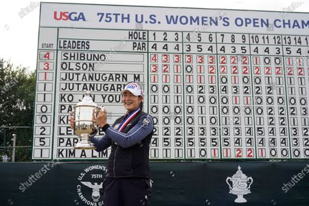 Lim Kim, of South Korea, holds up the championship trophy after winning the U.S. Women's Open golf tournament, in Houston