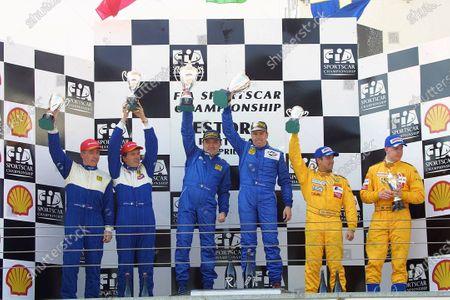 The SR2 podium (Left to Right) Fabio Mancini (ITA), Gianni Collini (ITA), Piergiuseppe Peroni (ITA), Mirko Savoldi (ITA), Niklas Loven (SWE), Mattias Andersson (SWE). FIA Sportscar Championship, Rd2, Estoril, Portugal. 14 April 2002.
