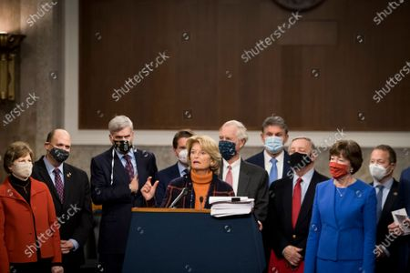 United States Senator Lisa Murkowski (Republican of Alaska) joins a bipartisan group of US Senators announcing the legislative text of the two bipartisan, bicameral COVID-19 emergency relief bills that propose to provide up to $908 billion in emergency relief on Capitol Hill in Washington, DC. The first will allocate $748 billion for more PPP assistance and an unemployment benefit; and a second $160 billion bill to provide aid for state and local governments and liability protections for businesses.