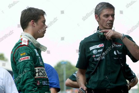 Stock Picture of Jaguar Racing test driver Andre Lotterer (GER), left,  listens intently to engineer Tony Burrows (GBR). Formula One Testing, Monza, Italy. 9-11 July 2002. DIGITAL IMAGE