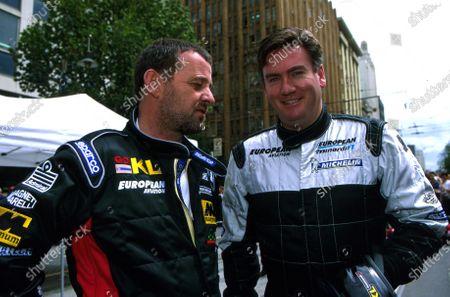 Minardi team owner Paul Stoddart (AUS), left, chats with TV presenter Eddie McGuire (AUS). Minardi Two Seater Experience, Australian Grand Prix, Melbourne, Australia. 1 March 2002.