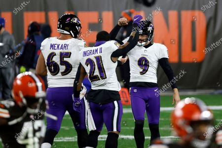 Baltimore Ravens place kicker Justin Tucker (9) is congratulated running back Mark Ingram II (21) and guard Patrick Mekari (65) after kicking the game winning field goal during an NFL football game against the Cleveland Browns, in Cleveland