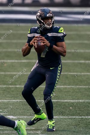 Stock Picture of Seattle Seahawks quarterback Geno Smith looks to pass during the second half of an NFL football game nagainst the New York Jets, in Seattle. The Seahawks won 40-3