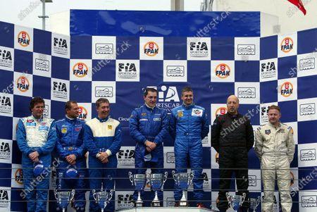 SR2 Podium and results: 1st: Piergiuseppe Peroni (ITA) / Mirko Savoldi (ITA) Lucchini Engineering, centre. 2nd: Gianni Collini (ITA) / Fabio Mancini (ITA) / Massimo Saccomanno (ITA) GP Racing, left. 3rd: Ranieri Randaccio (ITA) / Paul Daniels (GBR) SCI, right. FIA Sports Car Championship, Estoril, Portugal, 13 April 2003. DIGITAL IMAGE.