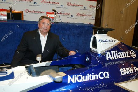 Stock Image of Tony Ponturo (USA), Vice President, Global Media and Sports Marketing, Anheuser-Busch Inc. BMW Williams F1 Team announce the official sponsorship of Anheuser-Busch and their Budweiser brand. 16 July 2003, London, England. DIGITAL IMAGE