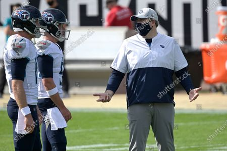 Stock Image of Tennessee Titans offensive coordinator Arthur Smith, right, talks with quarterback Ryan Tannehill (17) and quarterback Logan Woodside (5) during warmups before an NFL football game against the Jacksonville Jaguars, in Jacksonville, Fla
