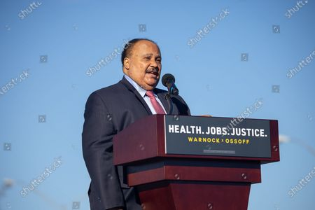 Martin Luther King III speaks before a rally in support of Democratic Senate candidates Reverend Raphael Warnock and Jon Ossoff in Atlanta on the first day of early voting