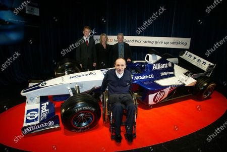 Frank Williams (GBR) Williams Team Owner sits alongside the Williams FW25 following a sponsorship deal with pharmaceutical company GlaxoSmithKline, who will promote their anti-tobacco product NiQuitin CQ. In the background are Simon Pulsford (GBR) (Left), General Manager and Vice President Glaxo SmithKline Consumer Healthcare, and Sir Paul Nurse (GBR) Joint Director General of Cancer Research UK (Right). Williams Sponsorship Unveiling, Riverside Studios, London, England, 15 April 2003. DIGITAL IMAGE