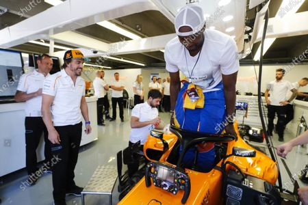 Spaniard Serge Ibaka Congolause of the NBAs Toronto Raptors tries the seat in the car of Fernando Alonso, McLaren MCL33 Renault.