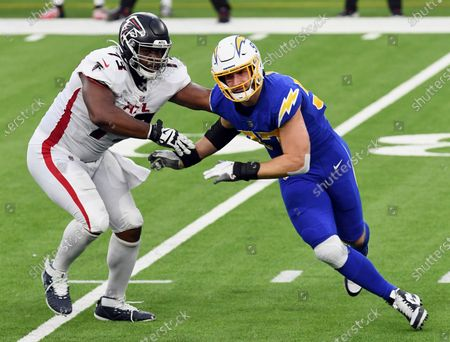 Los Angeles Chargers defensive end Joey Bosa (97) gets past Atlanta Falcons tackle Matt Gono (73) and chases after the quarterback during an NFL football game against the Falcons, in Inglewood, Calif. The Chargers defeated the Falcons 20-17