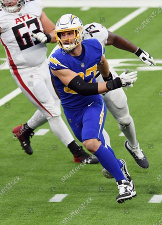 Los Angeles Chargers defensive end Joey Bosa (97) chases after the quarterback during an NFL football game against the Atlanta Falcons, in Inglewood, Calif. The Chargers defeated the Falcons 20-17