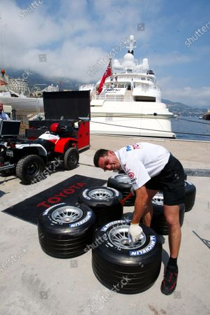 A Toyota mechanic marks the Michelin tyres for the team. Formula One World Championship, Rd 6, Monaco Grand Prix, Preparations, Monte Carlo, 19 May 2004. DIGITAL IMAGE