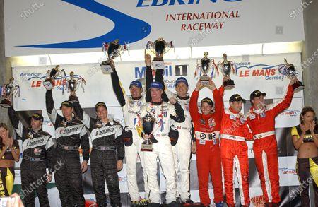 GTS class Podium and Results: 1st: Max Papis (ITA) / Johnny O'Connell (USA) / Ron Fellows (CDN) Chevrolet, centre. 2nd: Thomas Biagi (ITA) / John Bosch (NED) / Danny Sullivan (USA) Barron Connor Motorsports, right. 3rd: David Brabham (AUS) / Terry Borcheller (USA) / Johnny Mowlem (GBR) Team ACEMCO, left. American Le Mans Series, Sebring 12 Hours, Sebring, USA, 20 March 2004. DIGITAL IMAGE