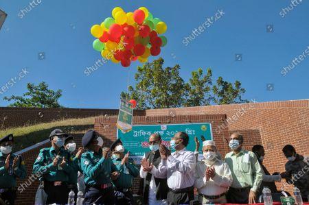 "Police Commissioner of Sylhet Metropolitan Police (Left), Mashuq Uddin Ahmed (middle) - President at Bangladesh Awami League Sylhet Metropolitan, and ZAKIR HUSSAIN (Right) General Secretary at Bangladesh Awami League Sylhet Metropolitan inaugurating the event ''Traffic Pokkhyo"" 2020 (Traffic Fortnightly- 2020)''"