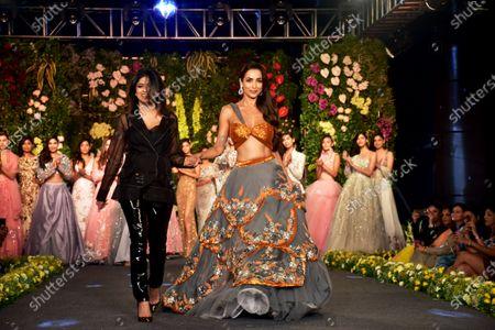 Malaika Arora seen walking the runway during the Kehia Karishma's designer show at the 2nd Edition of the Wedding Junction Fashion Show at Jio Garden in Mumbai, India.