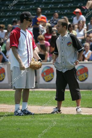 Kevin Richardson of the Backstreet Boys and Sebastien Lefebvre of Simple Plan play in a charity softball game against Simple Plan and the radio station KISS 103.5fm Chicago at Alexian Field in Schaumburg, IL.