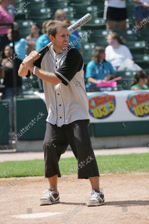 Sebastien Lefebvre of Simple Plan plays in a charity softball game against Simple Plan and the radio station KISS 103.5fm Chicago at Alexian Field in Schaumburg, IL.