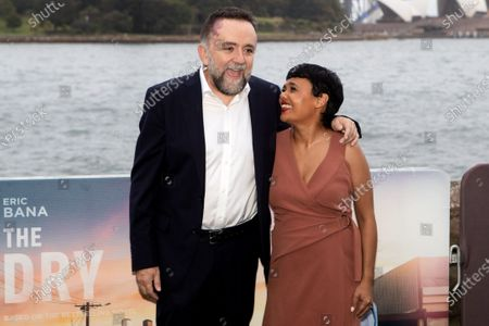 Director Robert Connolly and Miranda Tapsell walks the black carpet for the film premiere 'The Dry'
