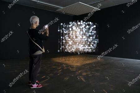 """Stock Image of A visitor looks at the artwork """"Continuel-mobil"""" of Argentinean artist Julio le Parc in the exhibition """"Tools for Utopia, selected works from the Daros Latinamerica collection"""" at the Kunstmuseum in Bern, Switzerland, 15 December 2020."""