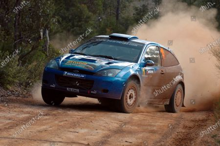 Anthony Warmbold (GER) with co-driver Gemma Price (GBR) Ford Focus WRC 02 on stage 6. FIA World Rally Championship, Rd 16, Telstra Rally Australia, Perth, Australia, Leg One, 11-14 November 2004. DIGITAL IMAGE