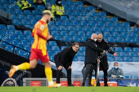 West Bromwich Albion's manager Slaven Bilic centre watches the game as Manchester CityÕs head coach Pep Guardiola right pleads for more time with fourth official Anthony Taylor