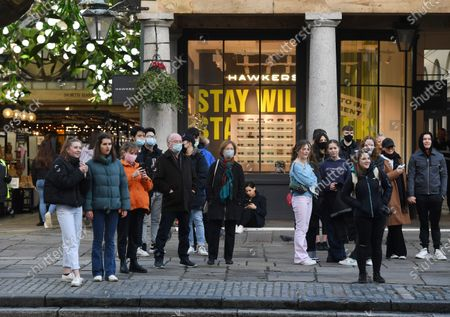 Pedestrians in Covent Garden in London, Britain, 15 December 2020. Britain's health secretary Matt Hancock has announced that London and its surrounding areas will be placed under  Tier 3 which is the toughest level in England's three-tier system. Londoners won't be able socialize indoors and bars, pubs and restaurants must close except for takeout.