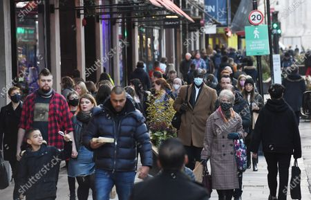 Stock Picture of Shoppers in Regent Street in London, Britain, 15 December 2020. Britain's health secretary Matt Hancock has announced that London and its surrounding areas will be placed under  Tier 3 which is the toughest level in England's three-tier system. Londoners won't be able socialize indoors and bars, pubs and restaurants must close except for takeout.