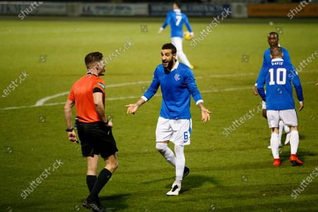 Connor Goldson of Rangers and Referee David Dickinson
