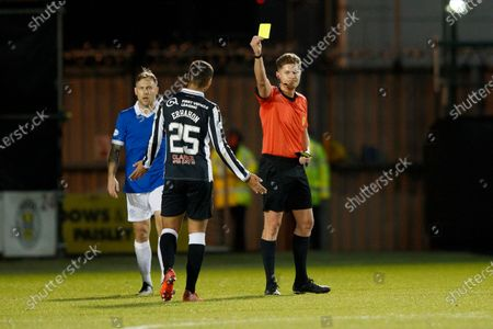 Referee David Dickinson books Ethan Erhahon of St Mirren for a foul on Bongani Zungu of Rangers .