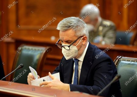 Italian Defense Minister Lorenzo Guerini looks at his notes during the meeting with Serbian Prime Minister Ana Brnabic (not pictured) in Belgrade, Serbia, 15 December 2020. Minister Guerini is on an official visit to Serbia.