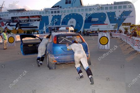 2004 FIA World Rally Championship,  Rally Italia Sardinia, Sept 30-Oct 3, 2004 Olbia, Sardinia. Antony Warmbold (GER) and Gemma Price (GBR) push their car into final service of Leg 1. Digital Image