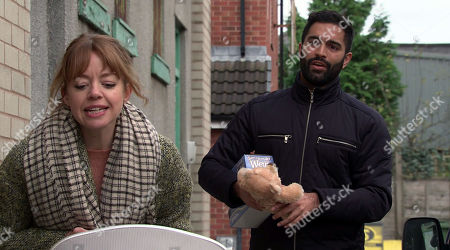 Stock Photo of Coronation Street - Ep 10206 & Ep 10207 Monday 28th December 2020  On the street, Toyah Battersby, as played by Georgia Taylor, and Imran Habeeb, as played by Charlie de Melo, fuss over Mason. As Toyah bends over the pram to give him a kiss, neither of them notices a grief stricken Leanne Tilsley watching from the window of her flat.