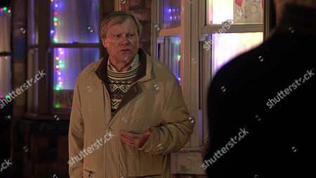 Stock Photo of Coronation Street - Ep 10211 & Ep 10212 Friday 1st January 2021 As Abi Franklin and Tyrone Dobbs lead a boycott outside Dev Alahan's shop, Roy Cropper, as played by David Neilson, breaks the news that the planning office has ruled against the development.