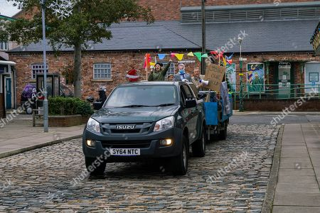 Coronation Street - Ep 10215 Wednesday 6th January 2021 - 1st Ep Abi Franklin's, as played by Sally Carman, determined to take action and arrives on a float, using a loudhailer to spread the word about evil Ray Crosby. As she yells defamatory statements about him he makes a discreet phone call.