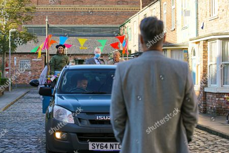 Coronation Street - Ep 10215 Wednesday 6th January 2021 - 1st Ep Abi Franklin's, as played by Sally Carman, determined to take action and arrives on a float, using a loudhailer to spread the word about evil Ray Crosby, as played by Mark Frost. As she yells defamatory statements about him he makes a discreet phone call.