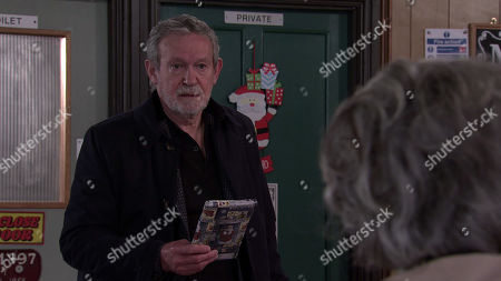 Coronation Street - Ep 10208 & Ep 10209 Wednesday 30th December 2020  Arthur, as played by Paul Copley, calls at the cafe with a belated Christmas present for Evelyn Plummer, as played by Maureen Lipman. Evelyn gives him short shrift and Arthur heads out deflated, leaving the present on the table.