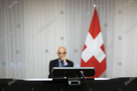Swiss Federal Councillor and health minister Alain Berset looks at the screen during a virtual meeting with European Ministers on vaccine strategies, in Bern, Switzerland, December 15, 2020.