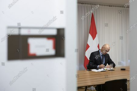 Swiss Federal Councillor and health minister Alain Berset prepares for a virtual meeting with European Ministers on vaccine strategies, in Bern, Switzerland, December 15, 2020.