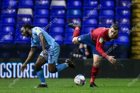 Stock Image of Fankaty Dabo #23 of Coventry City is fouled by Harry Toffolo #3 of Huddersfield Town