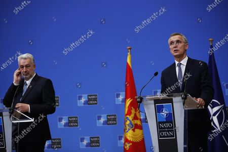 Secretary General Jens Stoltenberg, right, talks during a joint press conference with Montenegro Prime Minister Zdravko Krivokapic at the NATO headquarters in Brussels