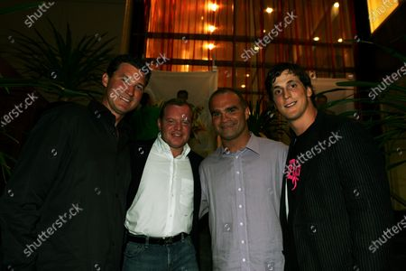 (L to R): Mario Lemieux (CDN) Pittsburg Penguins Ice Hockey legend with Alex Shnaider, Jordan Team Owner; Tie Domi, Toronto Maple Leafs Ice hockey player, and Vincent Lecavalier (CDN) Ice Hockey Player, at the Jordan Cocktail party. Formula One World Championship, Rd 8, Canadian Grand Prix, Practice Day, Montreal, Canada, 10 June 2005. DIGITAL IMAGE