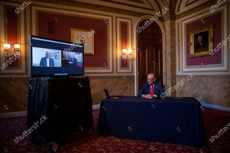 Senate Minority Leader Chuck Schumer meets virtually with President-elect Biden's nominee to be Secretary of Defense Lloyd Austin in the US Capitol in Washington, DC, USA, 15 December 2020. To be confirmed Austin will first need Congress to grant him a waiver to the law that requires the Secretary of Defense to be out of uniform for at least seven years.